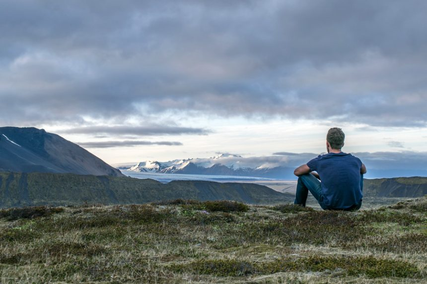 man-sitting-in-the-top-of-the-mountain-by-Anthony-Tori TITLE